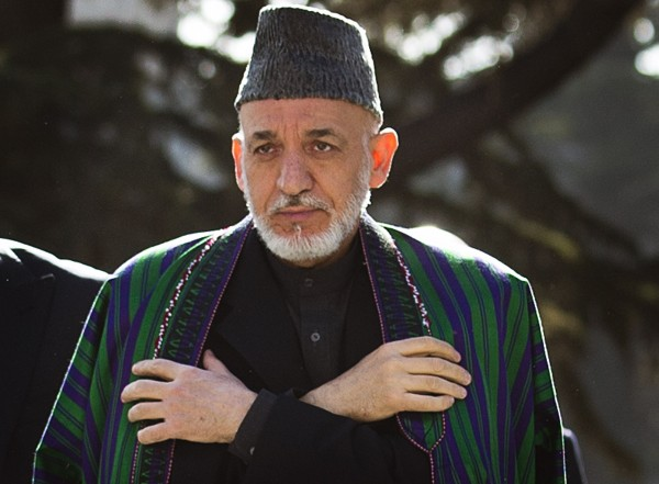 Afghan President Hamid Karzai arrives to review the guard of honor, during the first day of Eid Al Adha celebrations at the palace in Kabul, Afghanistan, Friday, Oct 26, 2012. Karzai called on Taliban to embrace peace and to join the government and lay down their arms.
