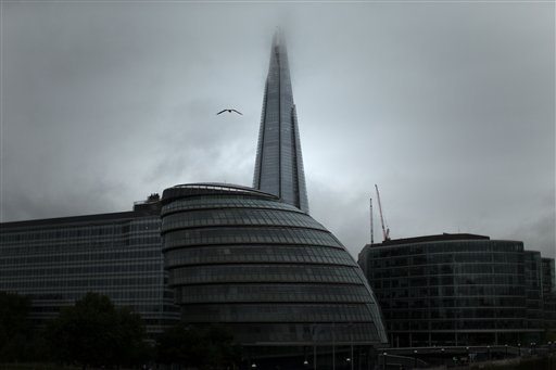 Clouds cover the top of the Shard skyscraper on a rainy day in London on Monday, Oct. 1, 2012.  The Shard was officially opened in July and stands at 1,016 feet high, making it the tallest building in western Europe.