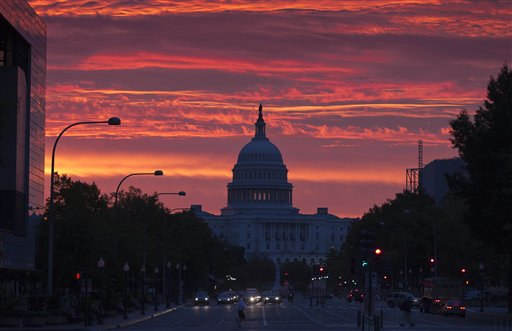 The Capitol dome is silhouetted as the sun rises in Washington on Monday, Oct. 15, 2012.