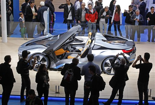 Visitors take snapshots of the BMW i8 concept car, at the end of the first week of the Paris Auto Show on Saturday, Oct. 6, 2012.