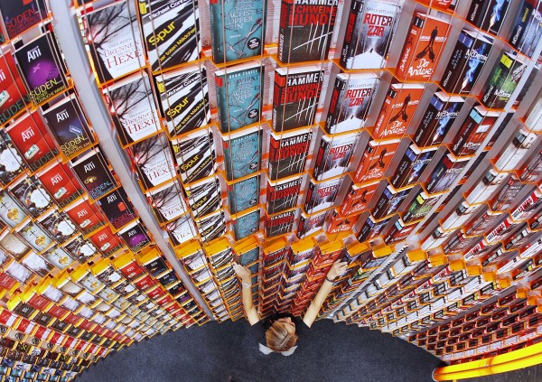 A women arranges books on a shelf at the Frankfurt Book Fair that will be opened later in the day  in Frankfurt, Germany, Tuesday, Oct. 9, 2012. New Zealand is this year's guest of honor at the book fair.