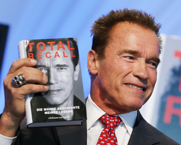 Former state governor of California Arnold Schwarzenegger displays his book &quotTotal Recall&quot on the first day of the Book Fair in Frankfurt, Germany, Wednesday, Oct. 10, 2012.
