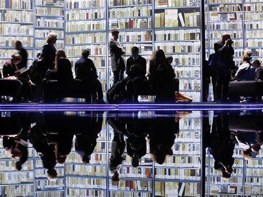 Visitors watch video screens in the New Zealand pavilion on the second day of the Book Fair in Frankfurt, Germany on Thursday, Oct. 11, 2012. New Zealand is this year's guest of honor.