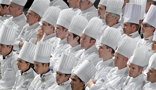 Cooks sit in the fair hall during the opening ceremony of the International Exhibition of Culinary Art (IKA) also known as the Culinary Olympics IKA in Erfurt, central Germany, on Friday, Oct. 5, 2012. About 1,600 chefs and pastry chefs and their support teams from 50 countries transform the fairgrounds into a platform of finest culinary art Oct. 5-10, 2012. 36 national teams, 28 national youth teams, eight national military teams and 14 community catering teams from all over the world take part at the competitions. The Culinary Olympics is the most important event for chefs and cooks from all over the world.
