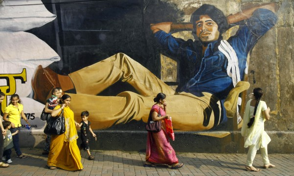 Indians walk past a giant portrait of Bollywood's biggest star Amitabh Bachchan painted on a wall, a day ahead of his 70th birthday, in Mumbai, India, Wednesday, Oct. 10, 2012. Affectionately known as &quotBig B,&quot Bachchan has acted in around 180 films in a career spanning four decades in Bollywood, the home of India's prolific movie industry.