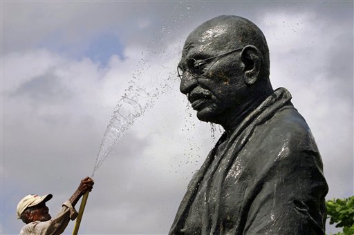 A worker sprays water on a statue of the late Mahatma Gandhi on the eve of his birth anniversary at Gandhi Park in Bhubaneswar, eastern India on Monday, Oct. 1, 2012. Gandhi, known as the &quotFather of the Nation,&quot was instrumental in the movement that lead to India's independence from Britain in 1947.