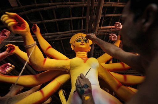 An artisan works on an idol of Hindu Goddess Durga at a workshop ahead of Durga Puja festival in Allahabad, India on Thursday, Oct. 11, 2012. Durga Puja will be celebrated from Oct. 20-24.