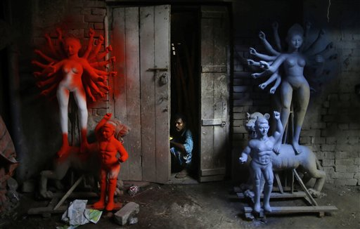 A laborer looks out of a workshop that prepares idols of goddess Durga in Kolkata, India on Tuesday, Oct. 16, 2012. Durga Puja, the festival dedicated to the worship of Goddess Durga begins on Oct. 20 and will continue until Oct. 24.
