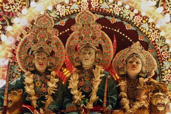 Indian artists dressed as Hindu gods, from left, Lakshmana, Rama and Sita, sit on a float during a Dussehra festival procession early in the morning in the northern Indian city of Allahabad, India, Saturday, Oct. 20, 2012. The procession was part of Hindu festival Dussehra celebrations, commemorating the triumph of Lord Rama over the demon king Ravana, marking the victory of good over evil.