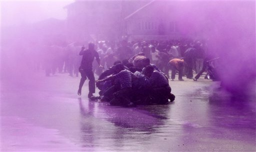 Police use colored water from a water cannon to disperse Kashmiri teachers during a protest in Srinagar, India on Wednesday, Oct. 3, 2012. Police in Indian-controlled Kashmir on Wednesday detained dozens of government teachers during a protest demanding a hike in salary and regularization of their jobs.