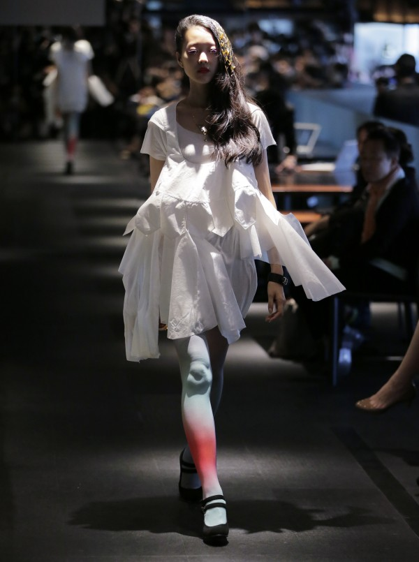 A model displays a creation by Olga during the 2013 spring/summer collection at Tokyo Fashion Week in Tokyo Wednesday, Oct. 17, 2012.