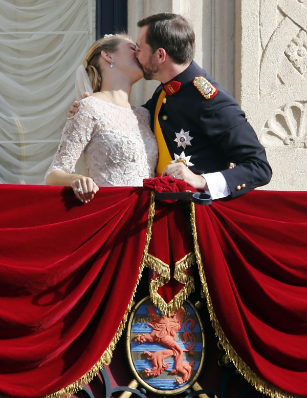 Luxembourg's Prince Guillaume and Countess Stephanie kiss on the balcony of the Royal Palace, with part of the Luxembourg coat of arms seen below, after their wedding in Luxembourg, Saturday, Oct. 20, 2012.