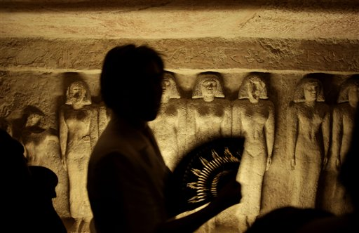 A tourist uses a hand fan, inside the tomb that belongs to Queen Meresankh III at the historical site of the Giza Pyramids, near Cairo, Egypt on Thursday, Oct. 11, 2012. When Queen Meresankh III died shortly after the reign of Khafre, Meresankh was buried in an extensively decorated mastaba tomb at Giza along with a rock-cut chapel. Inscriptions on the tomb provide both the time of her death and the date for her funeral, which followed some 272 days after her death.
