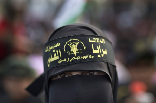 A veiled Palestinian supporter of the Islamic Jihad attends a rally to mark the 25th anniversary of the movement in Gaza City, Thursday, Oct. 4, 2012.