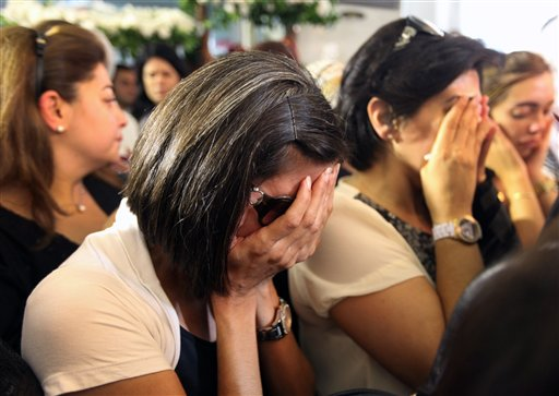 Lebanese women weep during the funeral of Brig. Gen. Wissam al-Hassan and his bodyguard Ahmad Sahyouni, who were assassinated on Friday by a car bomb, at Martyrs' Square in Beirut, Lebanon on Sunday, Oct. 21, 2012. Lebanese soldiers fired guns and tear gas to push back hundreds of protesters who broke through a police cordon and tried to storm the government headquarters in Beirut. The enraged crowd came from the funeral of a top Lebanese intelligence official assassinated in a massive car bombing.