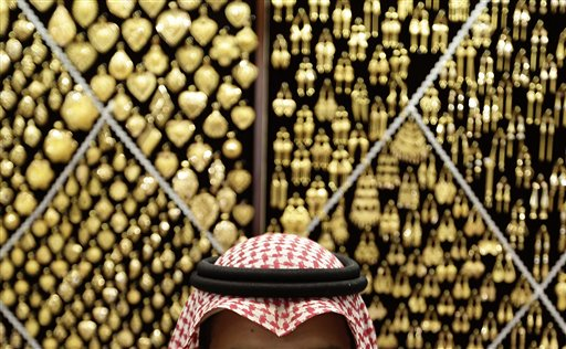 A Saudi vendor waits on customers at a gold shop in a market near the Grand Mosque in the holy city of Mecca, Saudi Arabia on Tuesday, Oct. 23, 2012. The annual Islamic pilgrimage draws three million visitors each year, making it the largest yearly gathering of people in the world.