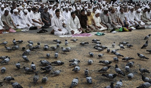 Muslim pilgrims pray outside the Grand Mosque in the holy city of Mecca, Saudi Arabia on Tuesday, Oct. 23, 2012. The annual Islamic pilgrimage draws three million visitors each year, making it the largest yearly gathering of people in the world.