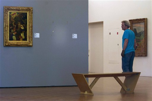 A man pauses to look at the empty space where Henri Matisse' painting &quotLa Liseuse en Blanc et Jaune&quot was hanging next to a painting by Maurice Denis at Kunsthal museum in Rotterdam, Netherlands on Tuesday Oct. 16, 2012. Seven paintings by artists including Pablo Picasso and Claude Monet were stolen from a museum in Rotterdam in an early-hours heist, Dutch police said Tuesday. The theft at the Kunsthal museum is one of the largest in years in the Netherlands, and is a stunning blow for the private Triton Foundation collection, which was being exhibited publicly as a group for the first time. The collection was on display as part of celebrations surrounding Kunsthal's 20th anniversary.