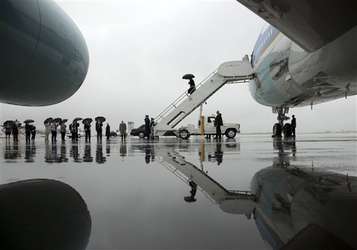 President Barack Obama arrives on Air Force One in the rain at Cleveland Hopkins International Airport on Friday, Oct. 5, 2012, in Cleveland.