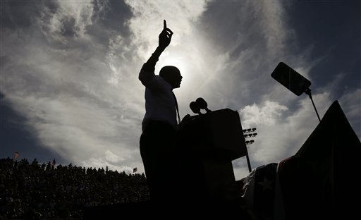 A silhouetted President Barack Obama gestures while speaking at a campaign event at Delray Beach Tennis Center on Tuesday, Oct. 23, 2012 in Delray Beach, Fla., the day after the last presidential debate against Republican Presidential candidate, former Massachusetts Gov. Mitt Romney. The president is making campaign stops in Florida and Ohio today.