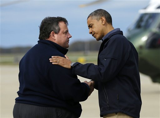 President Barack Obama is greeted by New Jersey Gov. Chris Christie upon his arrival at Atlantic City International Airport on Wednesday, Oct. 31, 2012, in Atlantic City, N.J. Obama traveled to the region to take an aerial tour of the Atlantic Coast in New Jersey in areas damaged by superstorm Sandy.