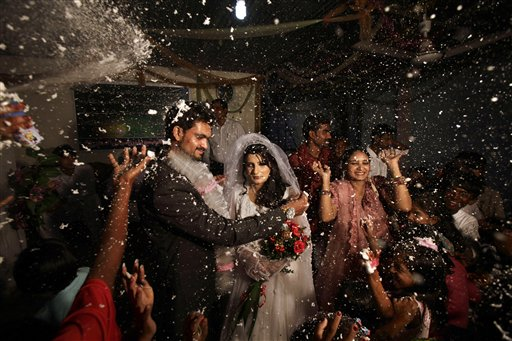 Pakistani groom, Phaloos Sohtra, 22, unveils his bride Shabana Gill, 20, during their wedding in a church in a Christian neighborhood in Islamabad, Pakistan on Friday, Oct. 5, 2012.