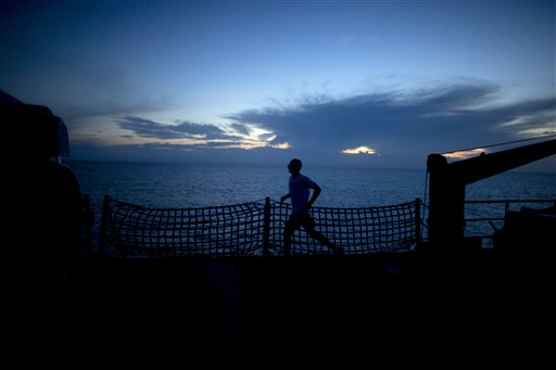 A sailor jogs top-deck after a celebration of the 237th birthday of the U.S. Navy aboard the USS Underwood while patrolling in international waters near Panama, Saturday, Oct. 13, 2012. The USS Underwood is on its final voyage before it's decommissioned.