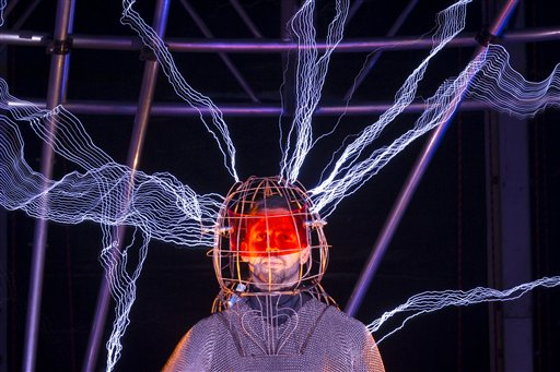 Magician David Blaine stands inside an apparatus surrounded by a million volts of electric currents streamed by tesla coils during his 72-hour &quotElectrified: 1 Million Volts Always On&quot stunt on Pier 54, Friday, Oct. 5, 2012, in New York. The stunt, sponsored by Intel, is the latest of daredevil endeavors by the magician whose previous stunts included being encased in ice for over 60 hours in Times Square.