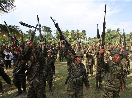 Members of the Moro Islamic Liberation Front shout &quotAllahu Akhbar,&quot or God is great, as they gather at their stronghold at Camp Darapanan in Maguindanao province in southern Philippines to coincide with the tentative peace-signing agreement between MILF and the Government at Malacanang Palace in Manila, Philippines on Monday, Oct. 15, 2012.