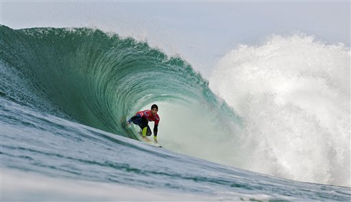 In this image provided by the Association of Surfing Professionals, Gabriel Medina of Brazil rides a wave during round 1 of the RipCurl Pro surfing competition Saturday, Oct. 13, 2012, in Peniche, Portugal. Medina advanced directly to round 3.