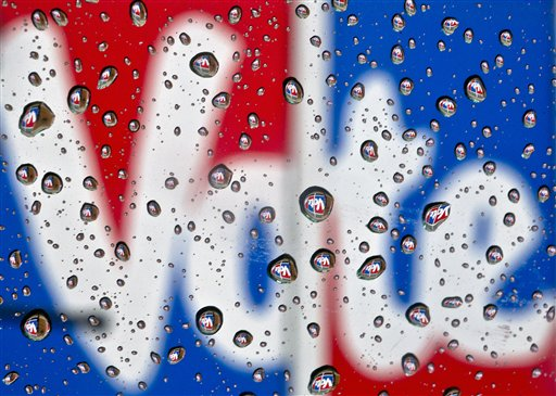 The word Vote, part of a mural to encourage voting, is reflected in raindrops in Danville, Ky., on Monday, Oct. 1, 2012. President Barack Obama and Republican challenger Mitt Romney are hunkered down Monday, practicing for their first debate to take place in Denver on Wednesday, Oct. 3.