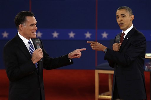Republican presidential nominee Mitt Romney and President Barack Obama spar during the second presidential debate at Hofstra University on Tuesday, Oct. 16, 2012, in Hempstead, N.Y.