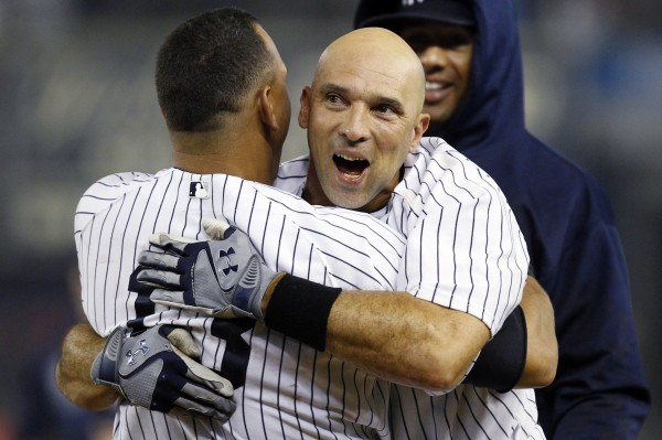 New York Yankees' Alex Rodriguez, left, embraces Raul Ibanez after Ibanez hit a 12th inning, walk-off RBI single to give the Yankees a 4-3 win in their baseball game against the Boston Red Sox at Yankee Stadium in New York, Tuesday, Oct. 2, 2012.