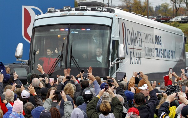 Republican vice presidential candidate Rep. Paul Ryan, R-Wis., left in front of bus, gives a thumbs-up to supporters as he arrives for a campaign rally at the Valley View Campgrounds in Belmont, Ohio, Saturday, Oct. 20, 2012, where he talked about economic conditions and the coal industry.