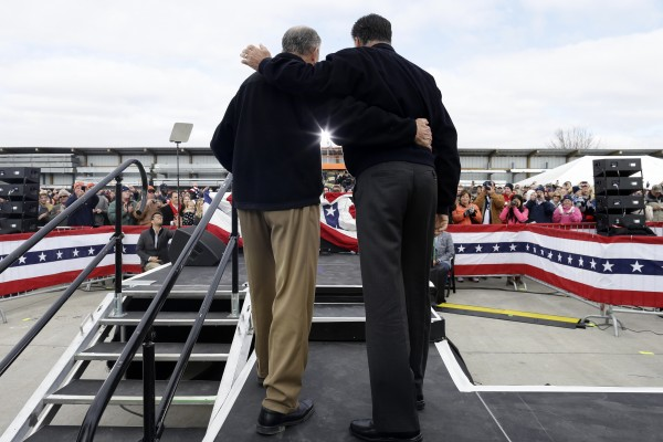 Republican presidential candidate former Massachusetts Gov. Mitt Romney is introduced by Sen. Chuck Grassley, R-Iowa, before he speaking about the economy at a campaign rally at Kinzler Construction Services in Ames, Iowa, Friday, Oct. 26, 2012.
