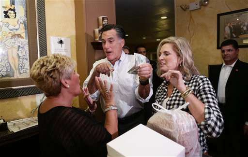 Republican presidential candidate and former Massachusetts Gov. Mitt Romney and his wife Ann insist on paying for their order during an unscheduled stop at La Teresita, a Cuban restaurant, in Tampa, Fla., on Friday, Oct. 5, 2012.
