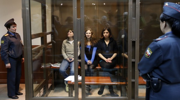 Feminist punk group Pussy Riot members (from left) Maria Alekhina, Yekaterina Samutsevich and Nadezhda Tolokonnikova sit in a glass cage at a court room in Moscow, Wednesday. Oct. 10, 2012. Three members of the punk band Pussy Riot are set to make their case before a Russian appeals court that they should not be imprisoned for their irreverent protest against President Vladimir Putin. Their impromptu performance inside Moscow's main cathedral in February came shortly before Putin was elected to a third term. The three women were convicted in August of hooliganism motivated by religious hatred and sentenced to two years in prison.