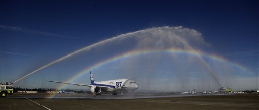 A Boeing 787 operated by All Nippon Airways taxis under a rainbow created by firetrucks at Seattle-Tacoma International Airport on Monday, Oct. 1, 2012, in Seattle, during an official welcome ceremony after it landed on the first day of service for the aircraft on ANA's Seattle-Tokyo route.