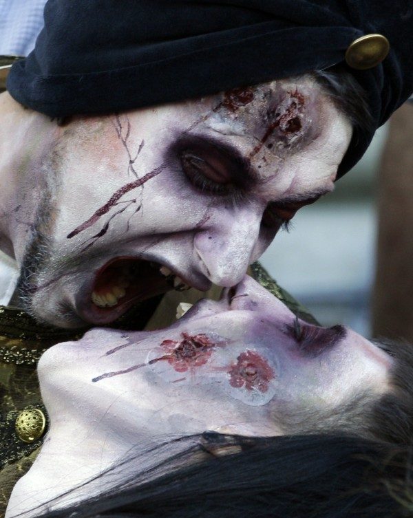 A couple pose together, dressed as zombies, as they attend the Zombie Walk in Belgrade, Serbia, on Saturday, Oct. 20, 2012.