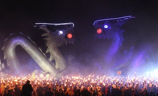People gather with torches to celebrate the Jipyongsun (horizon) Festival to experience the agricultural lifestyle in Gimje, South Korea on Saturday, Oct. 13, 2012.