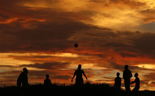 Sri Lankan youths play at dusk in Mirissa, about 88 miles south of Colombo, Sri Lanka on Sunday, Oct. 14, 2012.