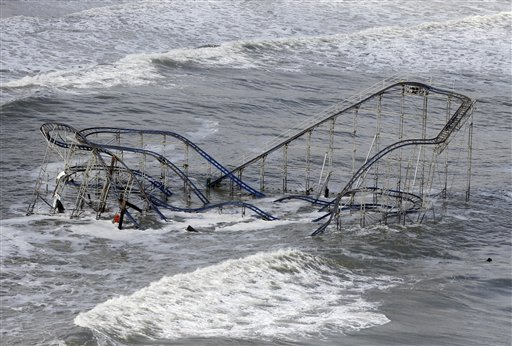 Waves wash over a roller coaster from a Seaside Heights, N.J. amusement park that fell in the Atlantic Ocean during superstorm Sandy on Wednesday, Oct. 31, 2012. New Jersey got the brunt of the massive storm, which made landfall in the state and killed six people. More than 2 million customers were without power as of Wednesday afternoon, down from a peak of 2.7 million.
