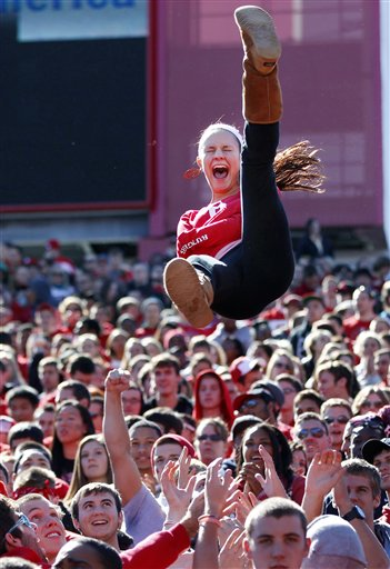 A fan is tossed in the air after a Rutgers touchdown during the first half of an NCAA college football game against Syracuse at High Points Solutions Stadium in Piscataway, N.J., Saturday, Oct. 13, 2012. Rutgers won 23- 15.