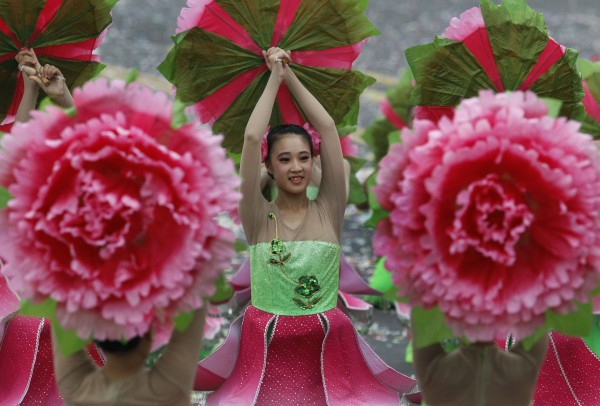 Young dancers perform during National Day celebrations marking the 101st anniversary of the founding of the Republic of China, in front of the Presidential Office in Taipei, Taiwan, Wednesday, Oct. 10, 2012. During the celebrations, President Ma Ying-jeou pledged greater efforts to fix the island's economy, now limping along at about a 2 percent annual growth rate.