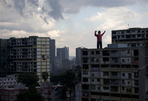 A giant inflatable doll representing President Hugo Chavez stands on top of a building in Caracas, Venezuela on Saturday, Oct. 6, 2012. Chavez is running for re-election against opposition leader Henrique Capriles in Sunday's presidential election.