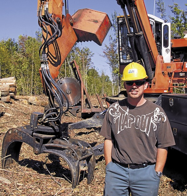 Adam Peters of Lee has worked 12 years for Chester-based Treeline Inc. At a harvest site in Orneville, he used a 2003 Serco 270 log loader to load tree-length logs onto truck trailers.