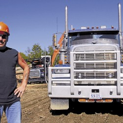 Arthur LaPlante of Howland has worked 18 years for Chester-based Treeline Inc. On this particular day, he waits as crane operator Adam Peters loads LaPlante's 1999 Freightliner with high-grade logs being sent to Chester