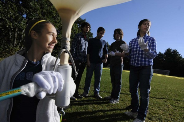 Sharon Audibert carefully holds onto a weather balloon as she and other Bangor High School STEM program students carefully prepare it for launch from Bangor High School's soccer field Thursday morning, Sept. 27, 2012.