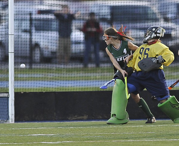 Belfast field hockey goalkeeper Julia Ward and Leavitt's Sadie Royer (4) each watch as a shot by Leavitt's Brianna DeGone goes in the goal in the second half of their state Class B championship game in Orono, Maine, Saturday, Oct. 27, 2012. Leavitt defeated  Belfast 1-0.