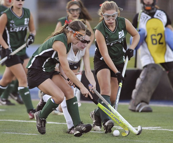 Leavitt's Sadie Royer (left) and Emma Martineau (20) double-team Belfast's Kelsey Grass for control of the ball in the second half of their state Class B championship game in Orono on Saturday. The Hornets won 1-0.